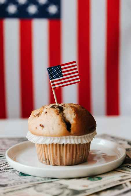dessert with flag on money against american flag on background